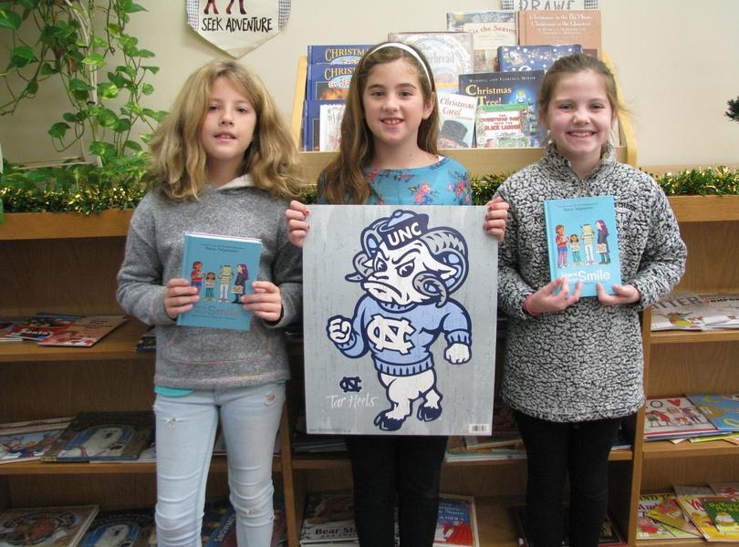 3 proud readers with their prizes from Friendship's Rainbow Reading Program