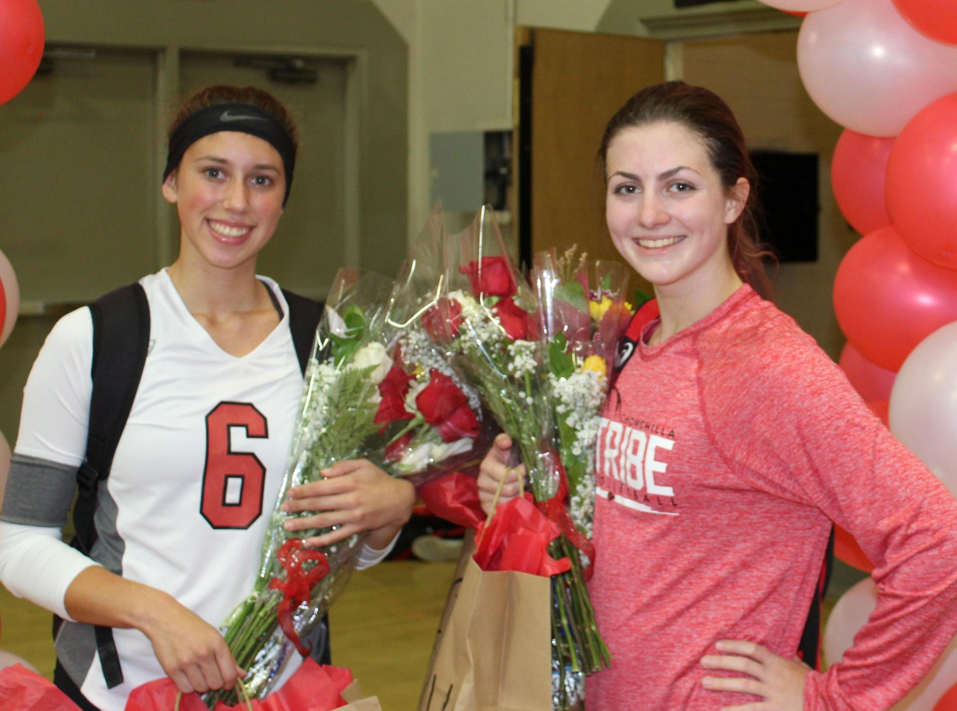 Savannah Bass and Emily Seals pose on Volleyball Senior Night.
