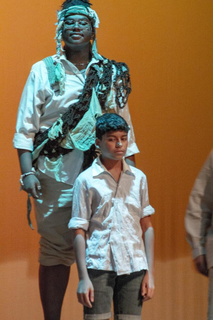 A scene from the play, with Young Daniel/Storyteller Phillip Fonseca in the foreground