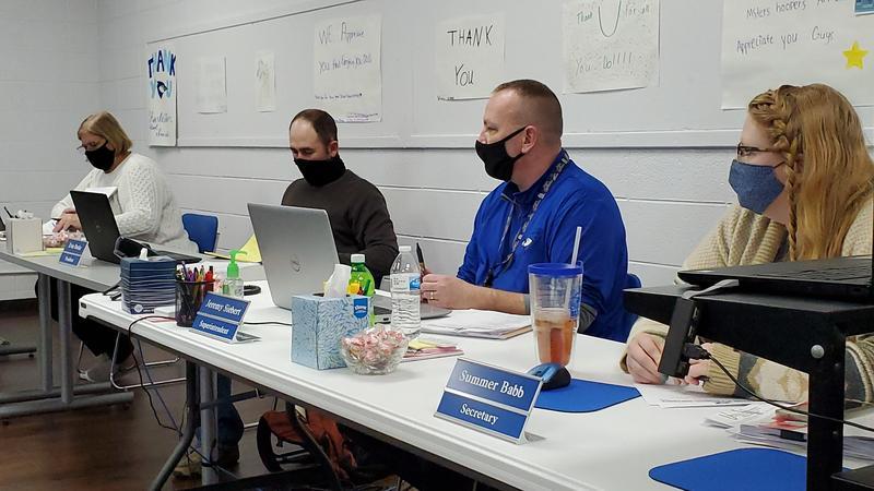 Pictured, left to right: Angie Duenne, Vice President; Evin Burke, President; Jeremy Siebert, Superintendent; Summer Babb, Secretary.