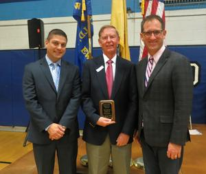 """During its annual Veterans Day assembly on Nov. 11, Roosevelt Intermediate School honored Helmuth Meditz, who served 5 years in the U.S. Army National Guard, with the """"Heroes Among Us"""" award.  Mr. Meditz is pictured here with Roosevelt principal Brian Gechtman (left) and teacher/assembly coordinator Brian Vieth."""