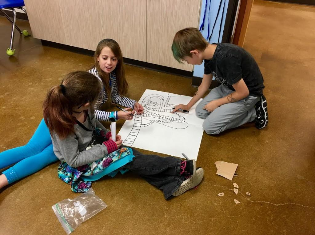 Fifth graders create metric math games to teach third graders about the metric system.