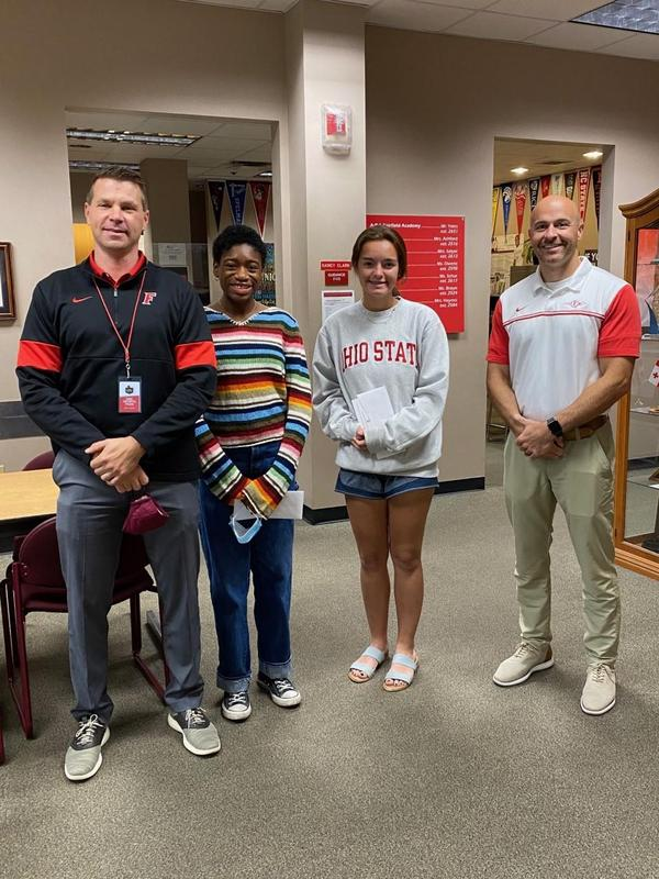 Photo of the high school principal with the two student honorees and their assistant principal.