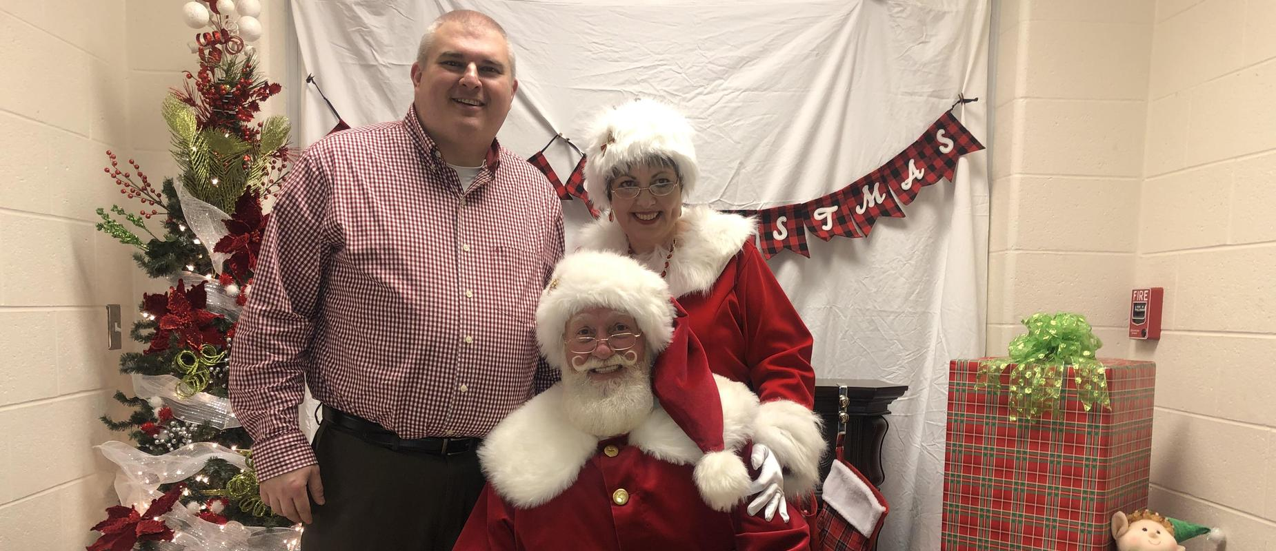 Principal Mr. Lee with Santa & Ms. Clouse