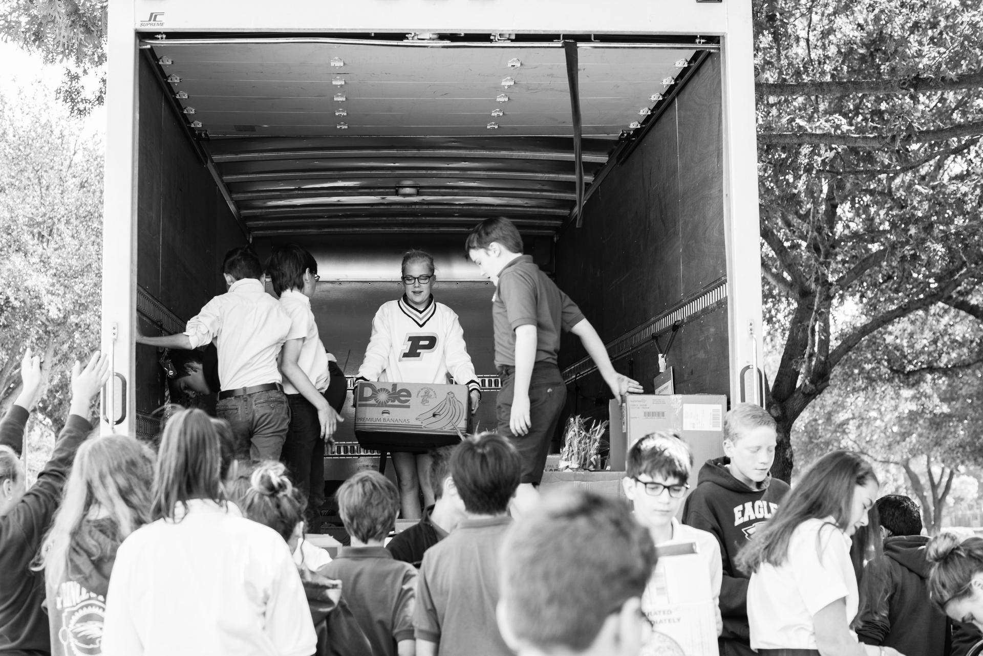 Students unloading truck at Food Bank