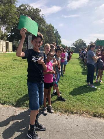 Sixth graders standing in a line