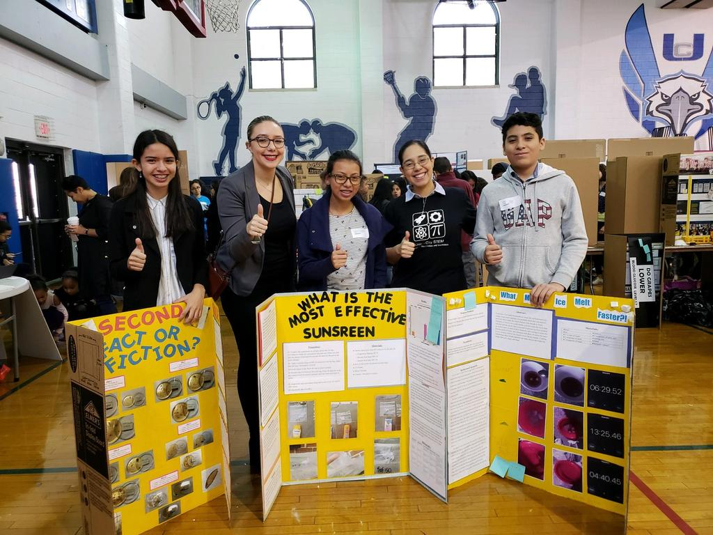 uhms students with ms velazquez and their research boards