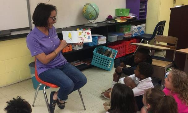 Mrs. Monique Smith sharing One Fish Two Fish Red Fish Blue Fish with her class in Jamaican Patois Style for International Literacy Day.