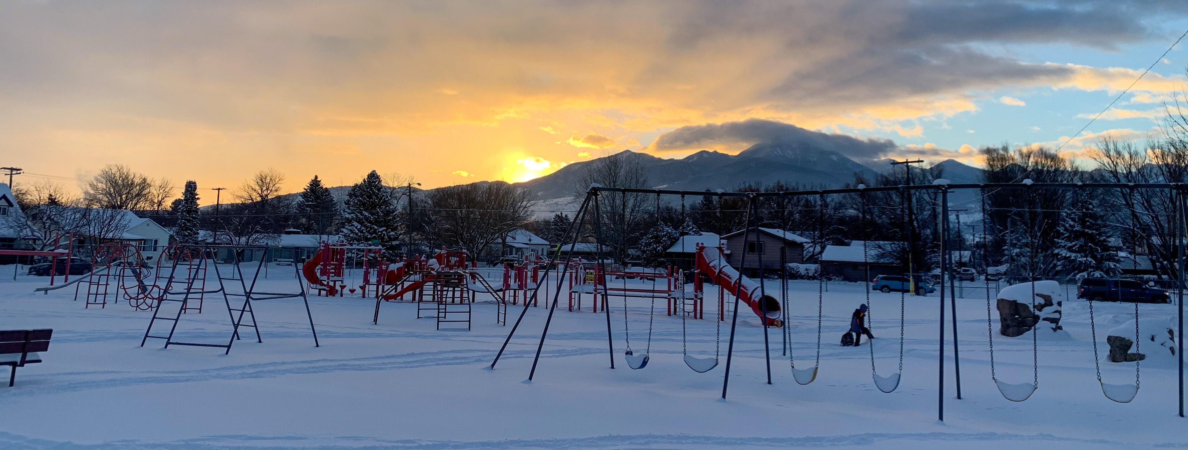 Winans playground with mountains and sunrise in background