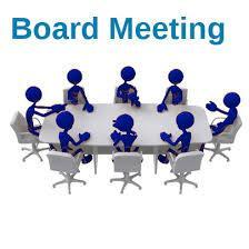 people sitting at a t meeting table