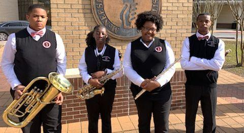 a photo of 4 Baker High symphonic band students who visited McNeese University on February 27, 2020