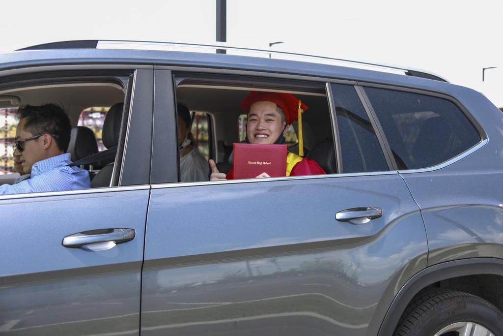 Graduate and family in a vehicle