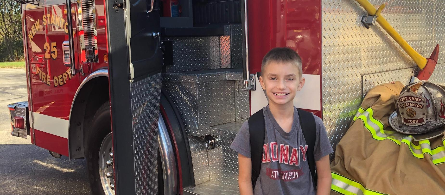 student and fire truck