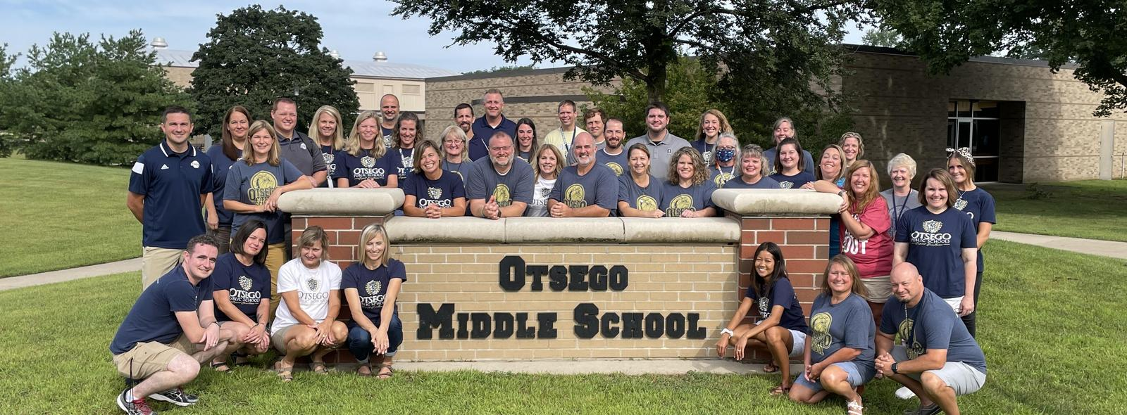 MS staff picture outside at the OMS sign