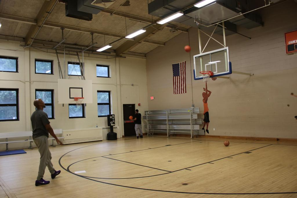 Staff member shooting basketball