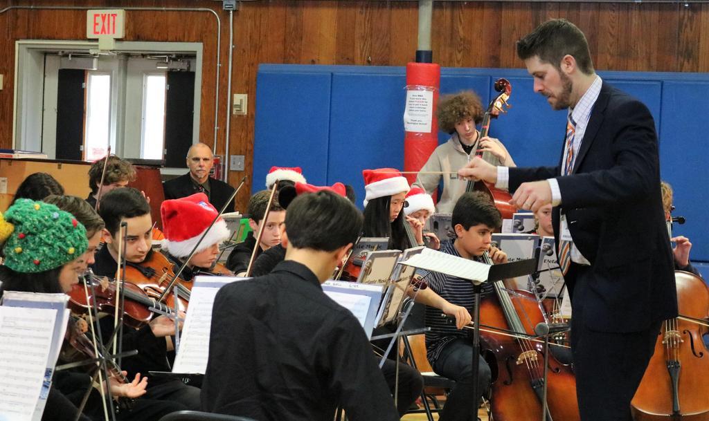 Photo of Roosevelt Intermediate School orchestra performing at Washington School.