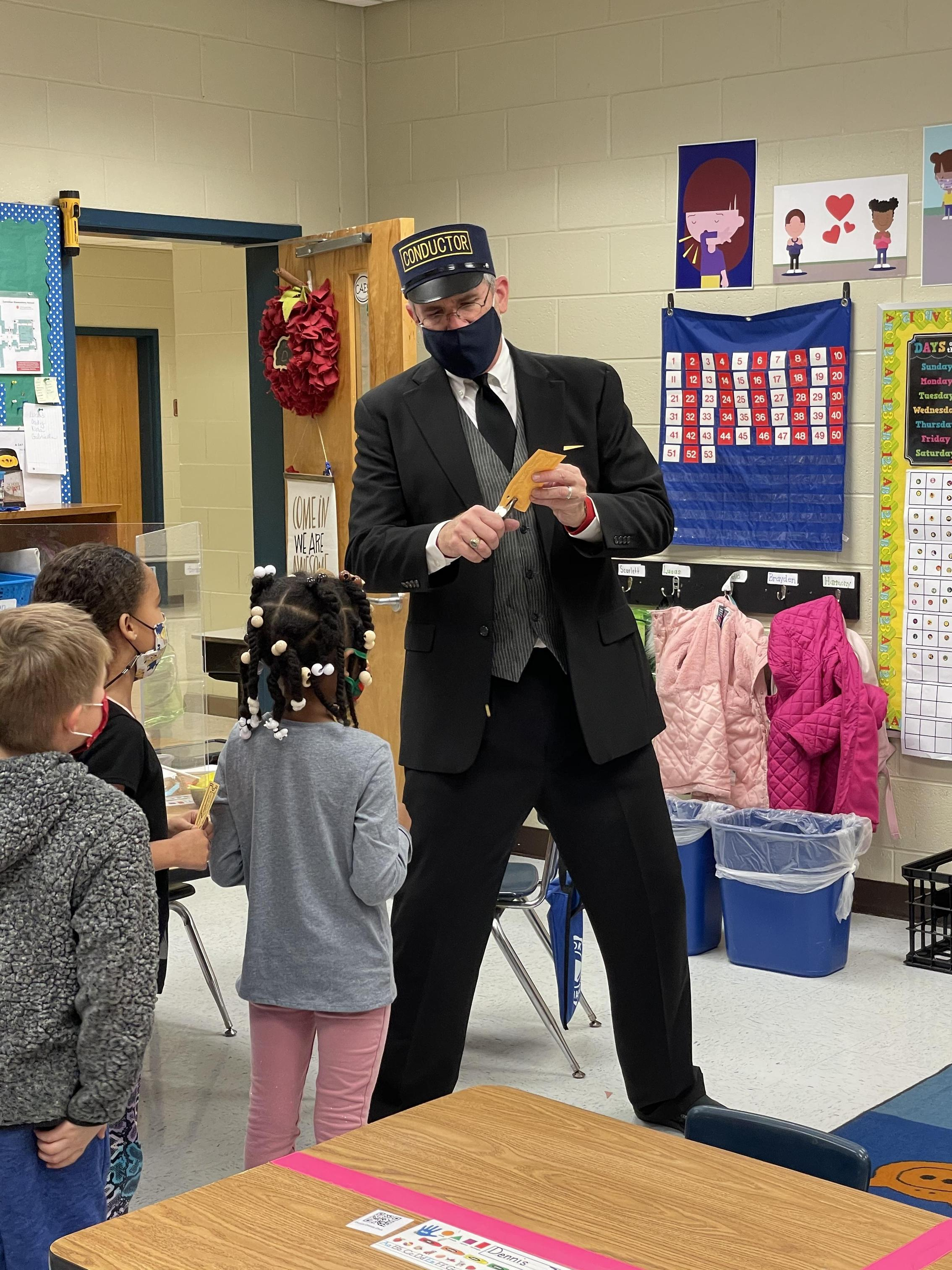 The Conductor of the Polar Express visits classes to punch tickets!