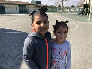 two kinder students showing off their crazy hair