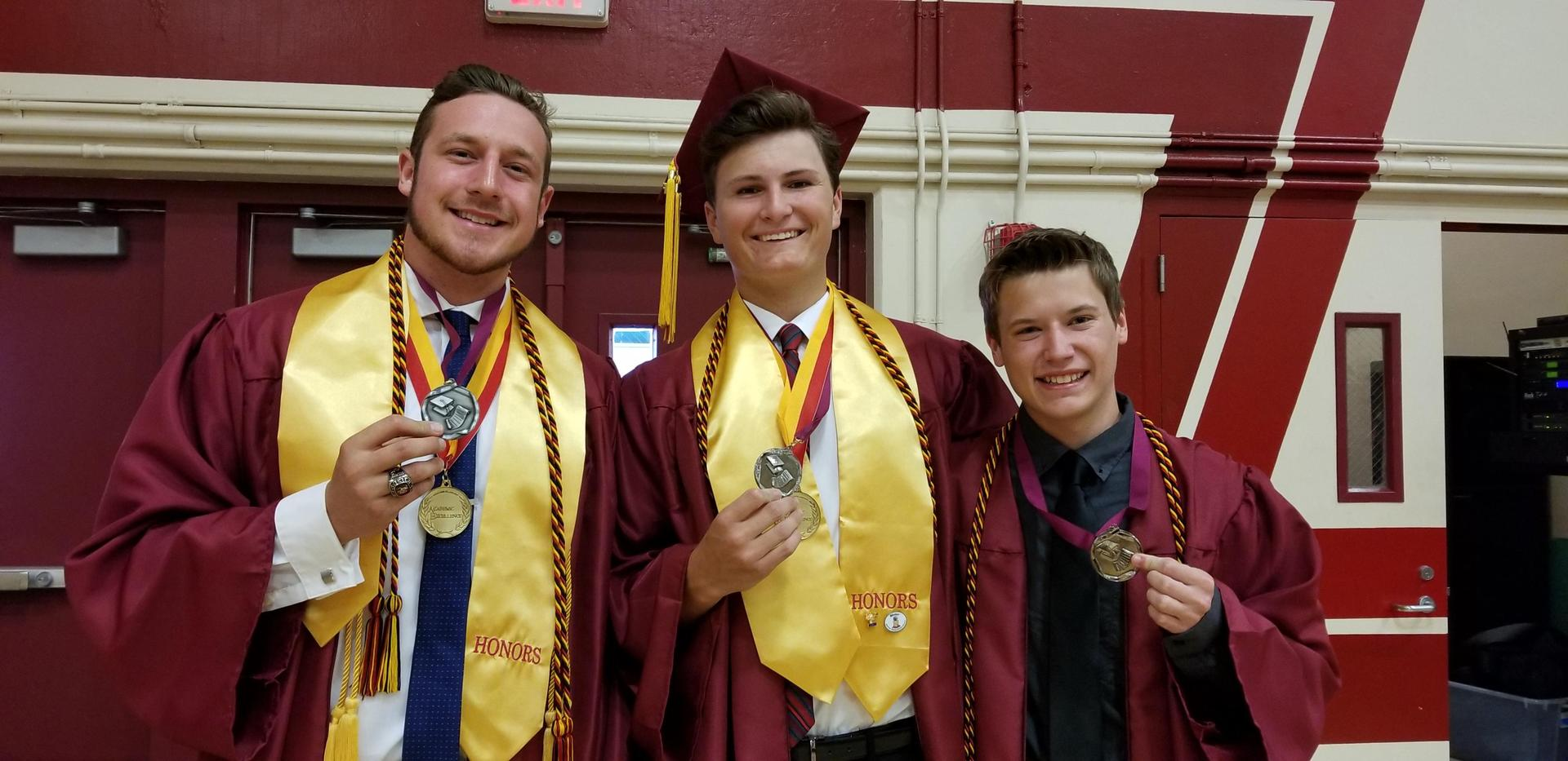 Students at Graduation wearing Biliteracy Medals
