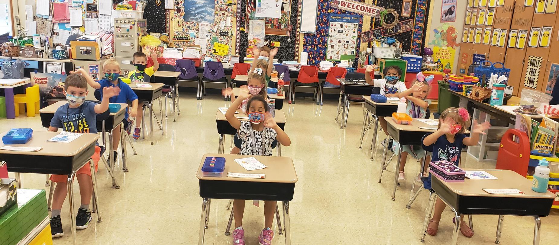 kindergarten students sitting at desks