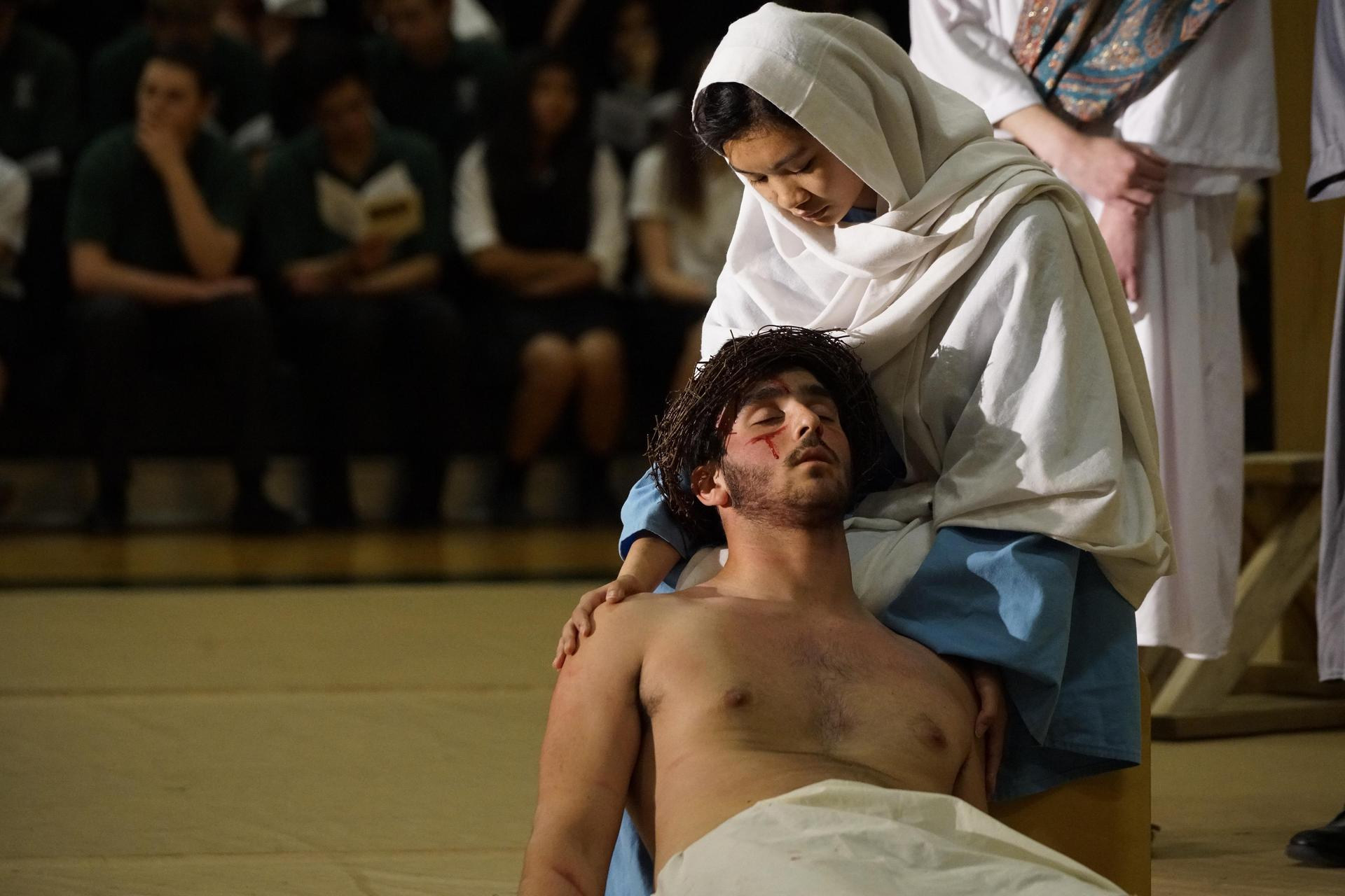Students perform Live Stations of the Cross