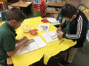Students used physical maps as references when sculpting their mountains and valleys