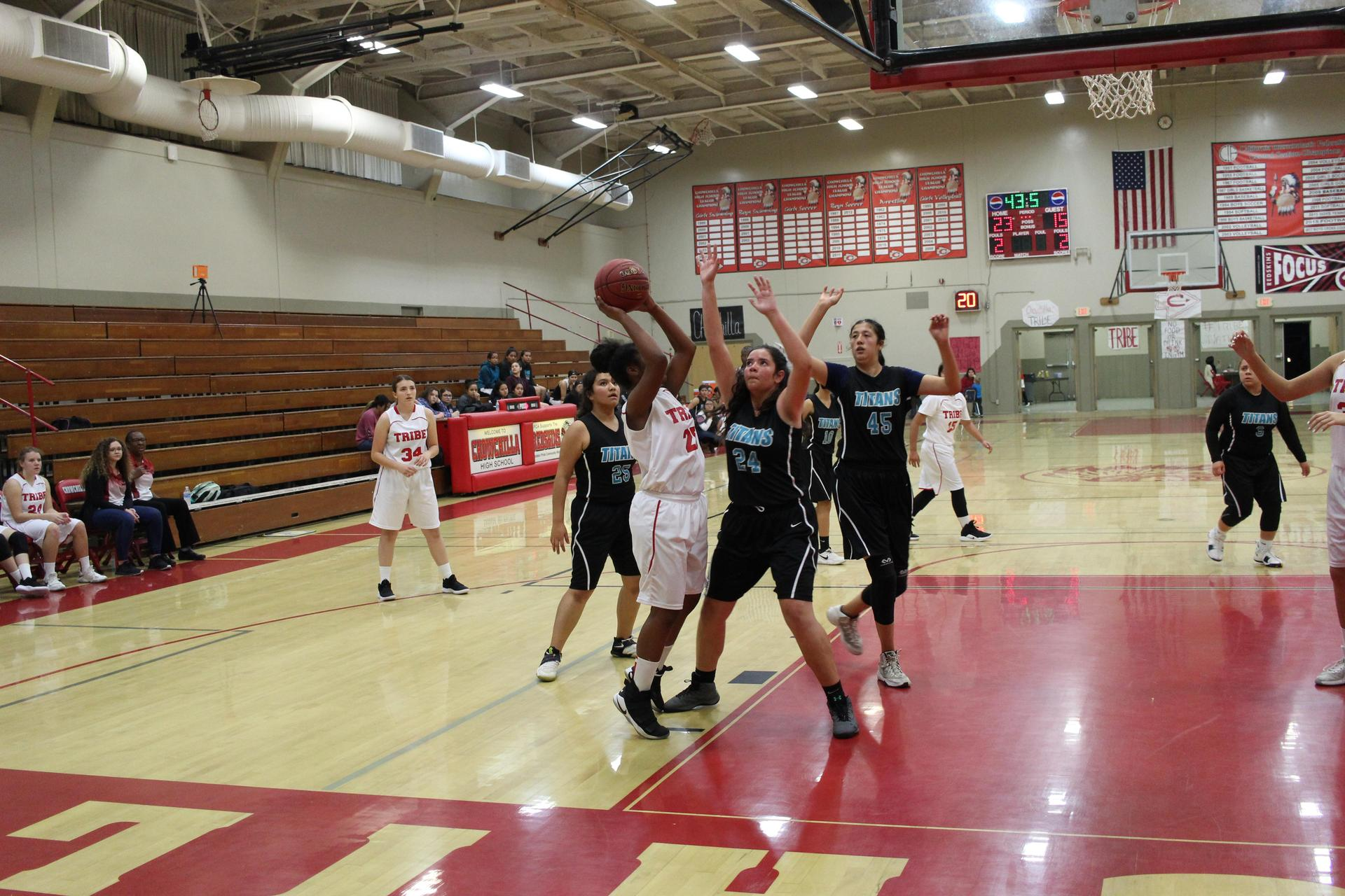 Girls playing basketball against Orange Cove