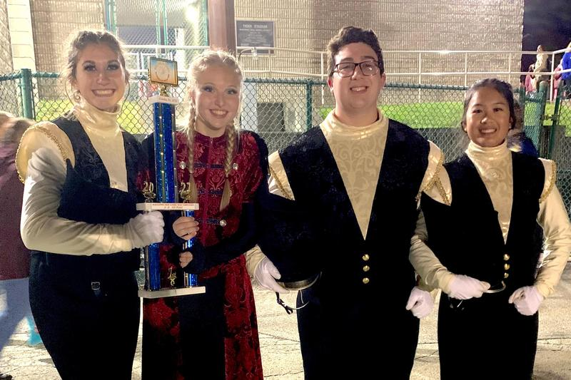 members of the band hold their first-place trophy