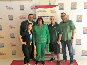 Tahquitz Cheer Coach Sarah Peterson, Assistant Superintendent of HR Derek Jindra, Riverside County Superintendent of Schools Dr. Judy White, Tahquitz Cheer Coach Michael Peterson, Tahquitz High School Principal Eric Dahlstrom in front of the event's banner