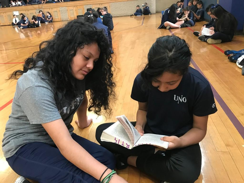 Students reading a chapter book