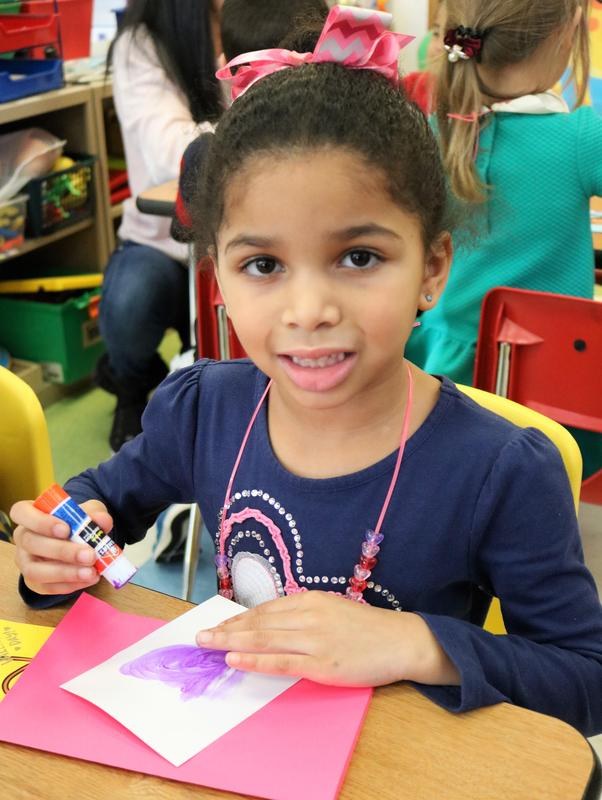 Photo of a Kindergartner at Lincoln School enjoying Valentine's Day activities.