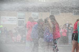 Students being sprayed with water