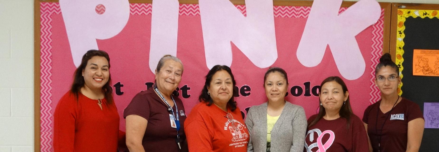 Parent Volunteers create bulletin board for Breast Cancer Awareness