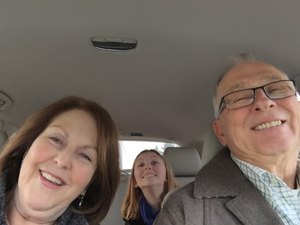 grandparents and granddaughter in car