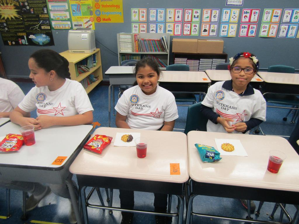 three 4th grade girls enjoying snacks