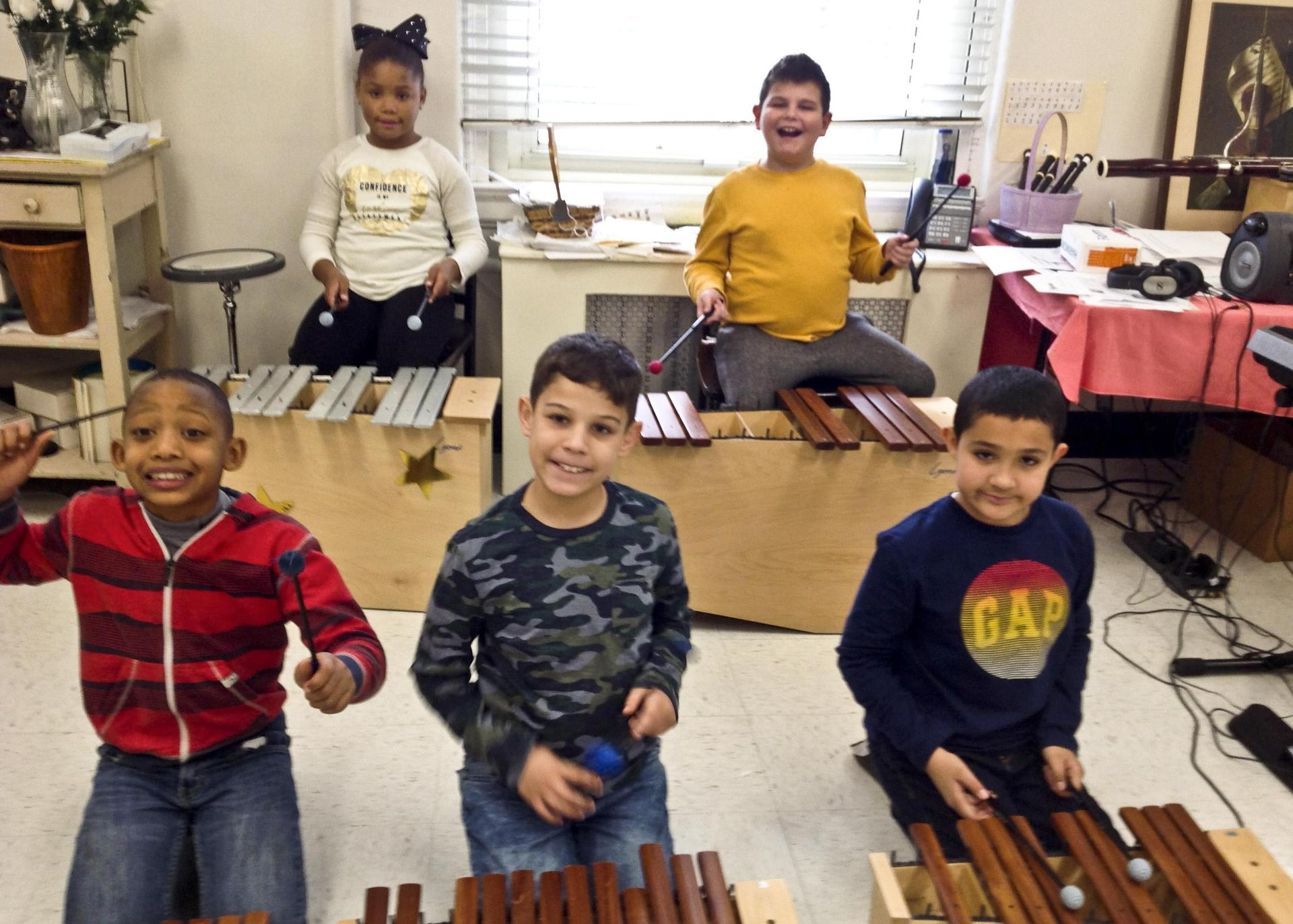 Five Van Cleve students on percussion instruments.