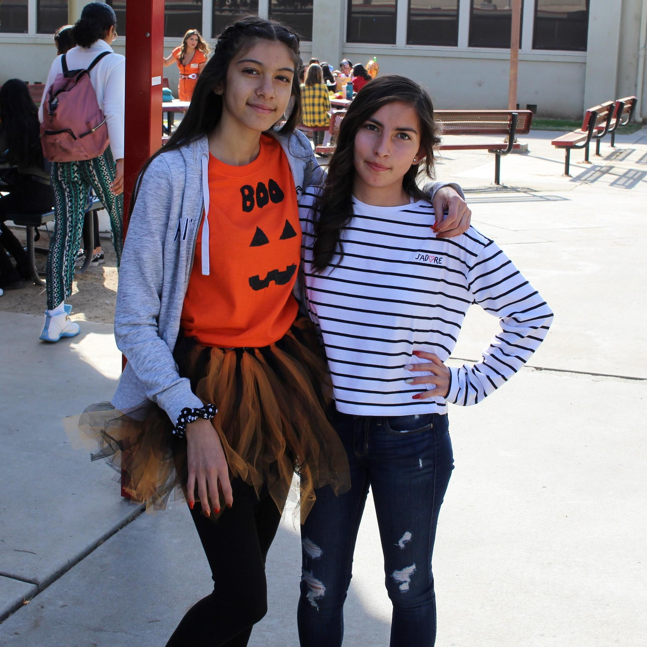 Carmen Martinez dressed as a pumpkin and Kimberly Palomino dressed as an inmate