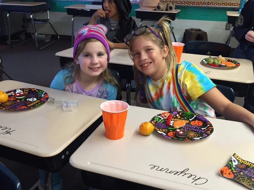 kids posing in Halloween costumes