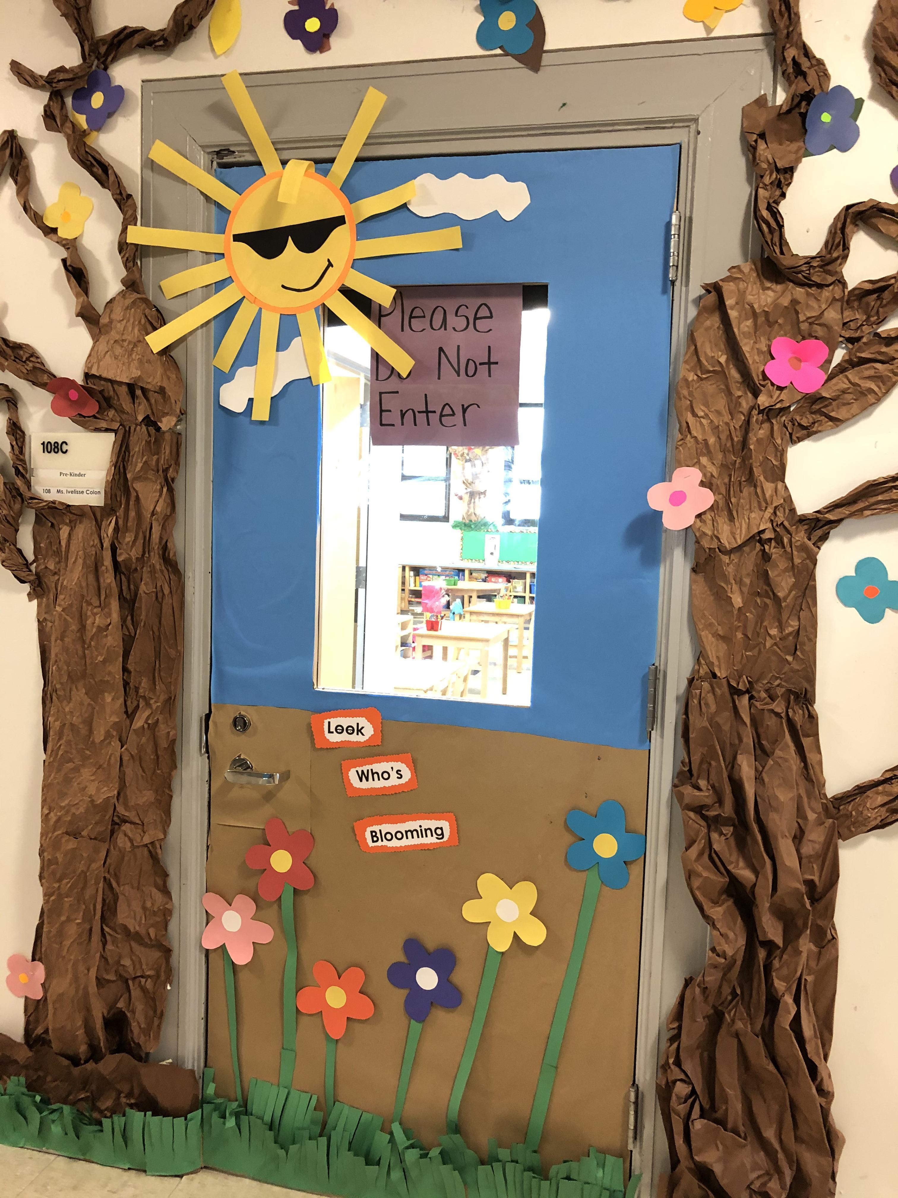 Spring decorated classroom door with trees on each side