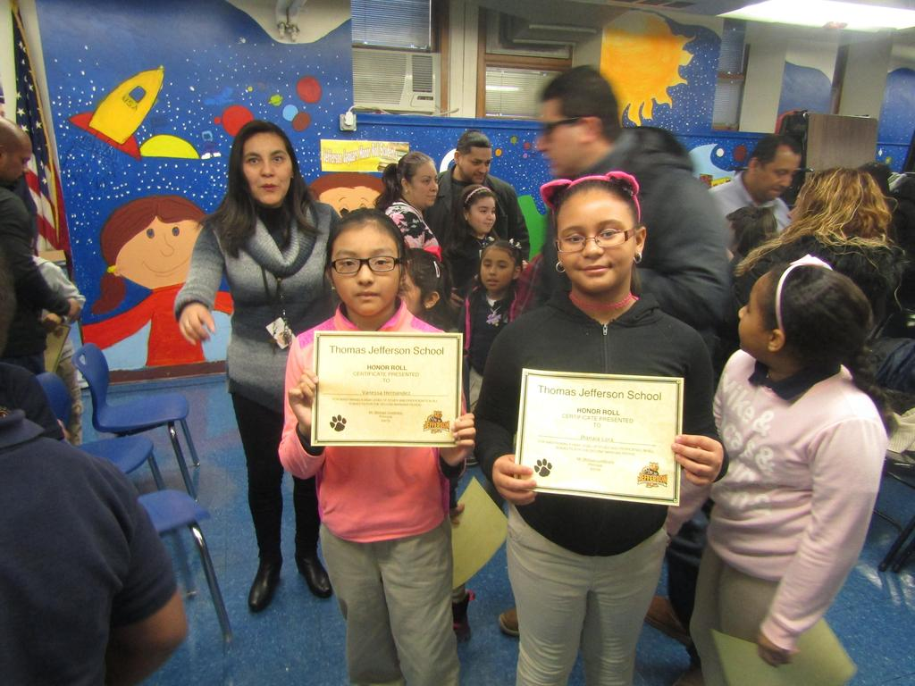 three girls showing off their certificates