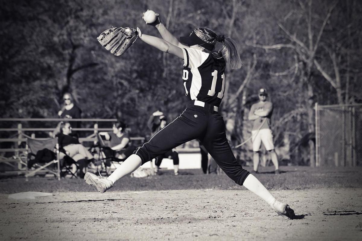 Girl pitching softball