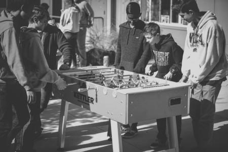 Students playing foosball at lunch.