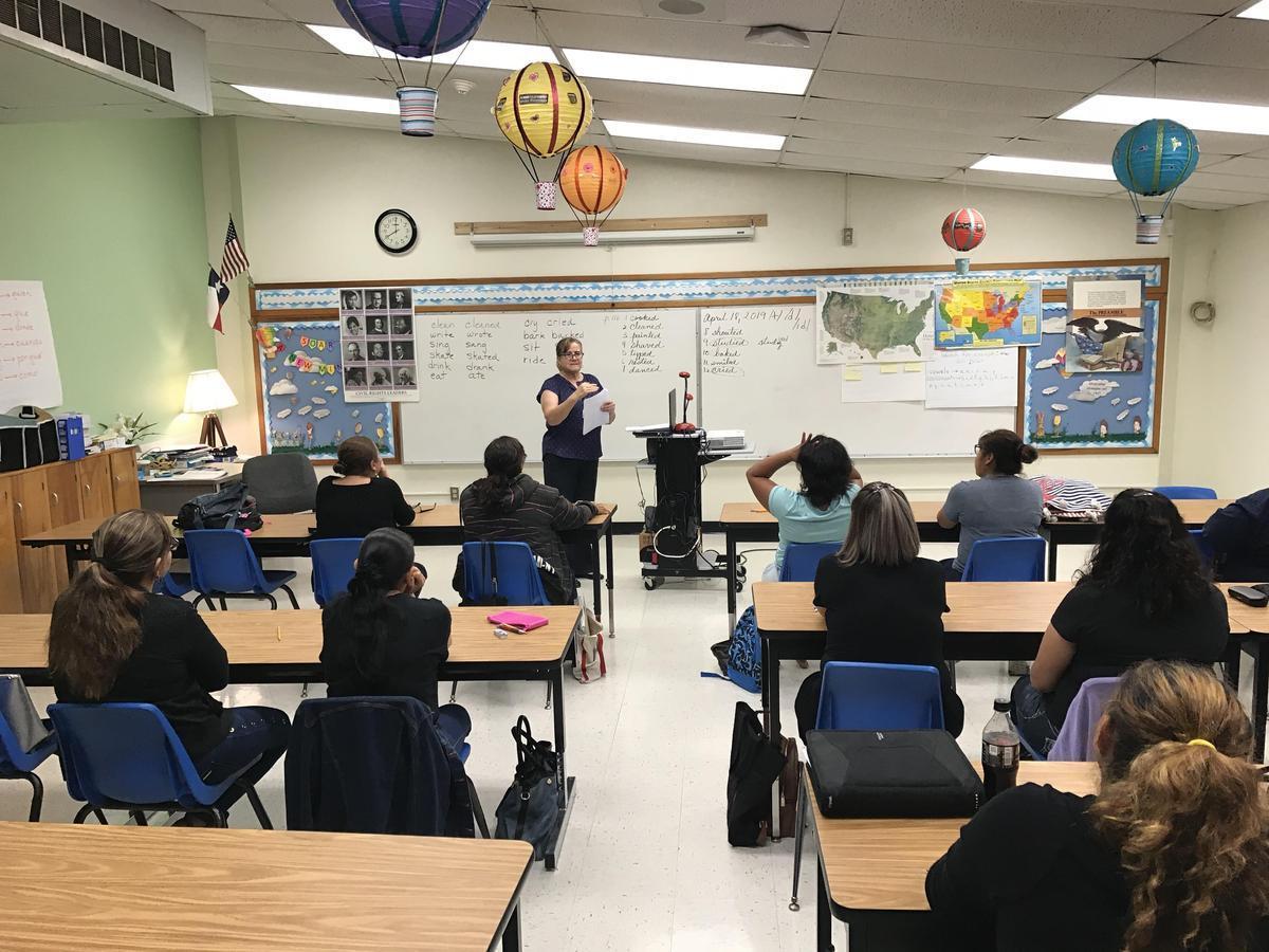 ESL Class-Teacher giving instruction to Parents