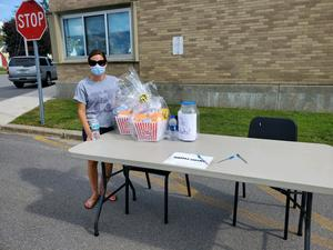 Volunteers with donations at the Heuvelton back-to-school event.
