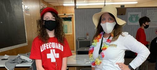 a picture of a student and teacher dressed as lifeguards