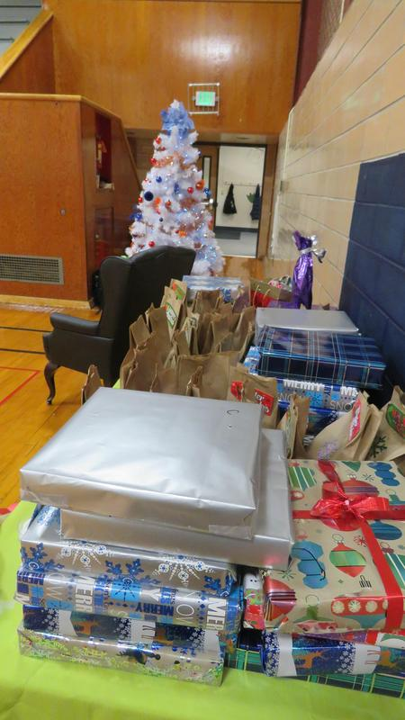 Gifts are lined up for children of the Community Family Shelter.