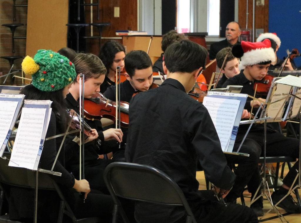 Photo of Roosevelt student orchestra performing at Washington School.