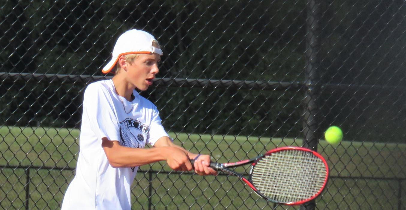 A TKHS tennis player returns a volley.