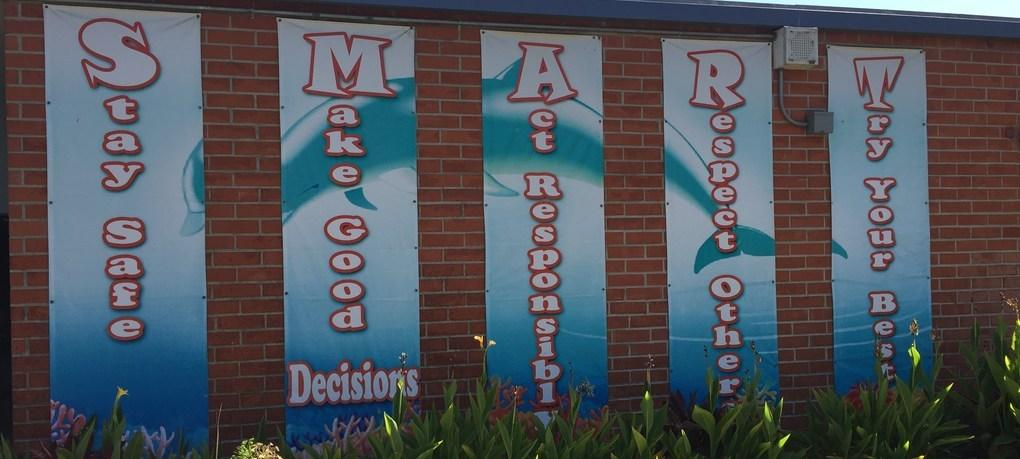 DeMille character banner brightens the front of the school