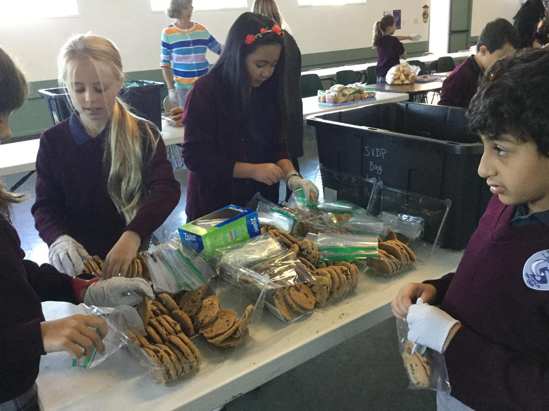 Fourth graders making lunches for a local soup kitchen